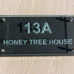 sandblasted engraved glass house number name sign mounted on slate